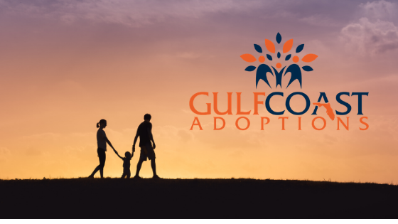 Adoptive family walking hand-in-hand